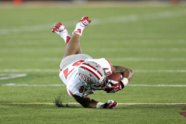 Aug 29, 2013; Minneapolis, MN, USA; UNLV Rebels wide receiver Maika Mataele (87) dives for a first down in the third quarter against the Minnesota Golden Gophers at TCF Bank Stadium. The Gophers won 51-23. Mandatory Credit: Jesse Johnson-USA TODAY Sports