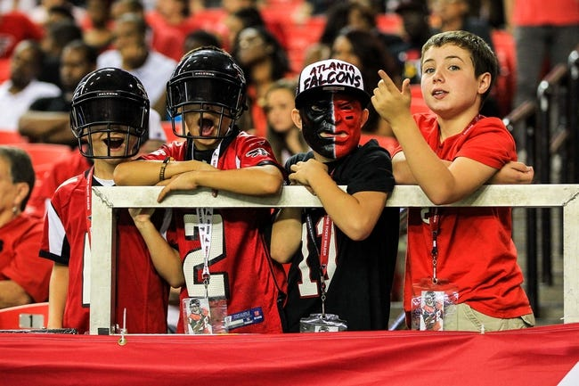 Aug 29, 2013; Atlanta, GA, USA; Atlanta Falcons fans watch from the stands in the second half against the Jacksonville Jaguars at the Georgia Dome. The Jaguars won 20-16. Mandatory Credit: Daniel Shirey-USA TODAY Sports