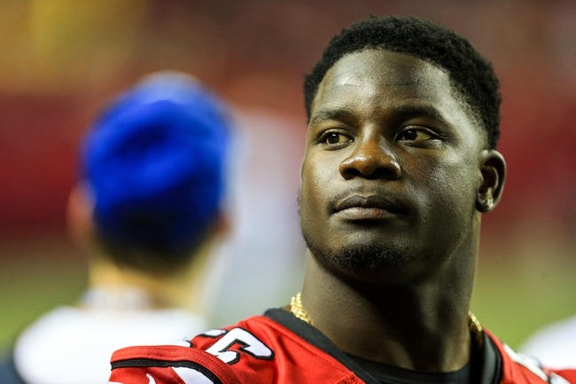 Aug 29, 2013; Atlanta, GA, USA; Atlanta Falcons outside linebacker Sean Weatherspoon (56) on the sidelines in the second half against the Jacksonville Jaguars at the Georgia Dome. The Jaguars won 20-16. Mandatory Credit: Daniel Shirey-USA TODAY Sports