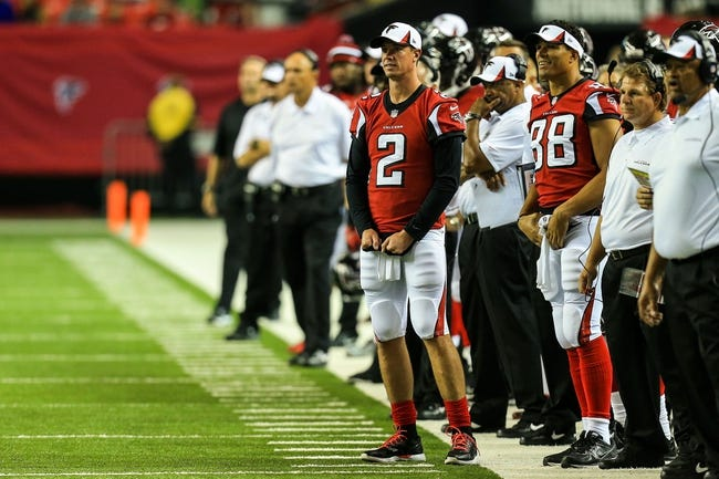 Aug 29, 2013; Atlanta, GA, USA; Atlanta Falcons quarterback Matt Ryan (2) and tight end Tony Gonzalez (88) watch from the sidelines in the second half against the Jacksonville Jaguars at the Georgia Dome. The Jaguars won 20-16. Mandatory Credit: Daniel Shirey-USA TODAY Sports