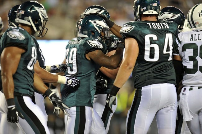 Aug 29, 2013; East Rutherford, NJ, USA; Philadelphia Eagles running back Matthew Tucker (39) celebrates a touchdown against the New York Jets during the second half of a preseason game at Metlife Stadium. The Jets won 27-20. Mandatory Credit: Joe Camporeale-USA TODAY Sports