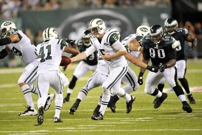 Aug 29, 2013; East Rutherford, NJ, USA; New York Jets quarterback Matt Simms (5) hands off to running back Mossis Madu (41) during the second half of a preseason game at Metlife Stadium. The Jets won 27-20. Mandatory Credit: Joe Camporeale-USA TODAY Sports