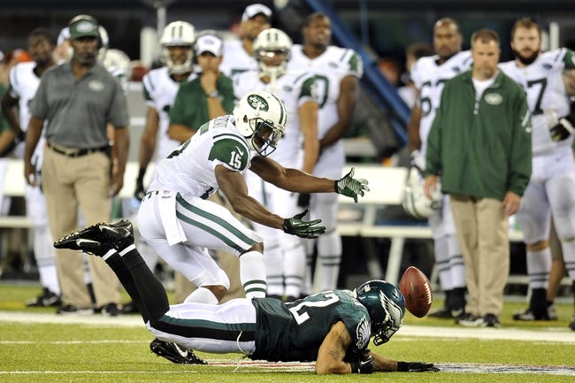 Aug 29, 2013; East Rutherford, NJ, USA; New York Jets wide receiver Ben Obomanu (15) is unable to make a catch during the second half of a preseason game at Metlife Stadium. The Jets won 27-20. Mandatory Credit: Joe Camporeale-USA TODAY Sports