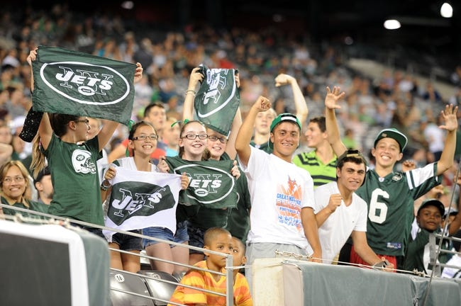 Aug 29, 2013; East Rutherford, NJ, USA; Football fans cheer during the second half of a preseason game between the New York Jets and Philadelphia Eagles at Metlife Stadium. The Jets won 27-20. Mandatory Credit: Joe Camporeale-USA TODAY Sports