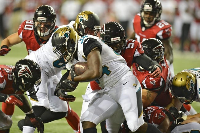 Aug 29, 2013; Atlanta, GA, USA; Jacksonville Jaguars running back Lonnie Pryor (34) is tackled by Atlanta Falcons linebacker Brian Banks (53) during the fourth quarter at the Georgia Dome. The Jaguars defeated the Falcons 20-16. Mandatory Credit: Dale Zanine-USA TODAY Sports