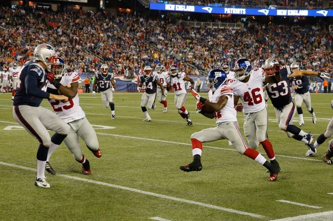 Aug 29, 2013; Foxborough, MA, USA; New York Giants defensive back Charles James (37) runs the ball against the New England Patriots in the fourth quarter at Gillette Stadium. Mandatory Credit: David Butler II-USA TODAY Sports