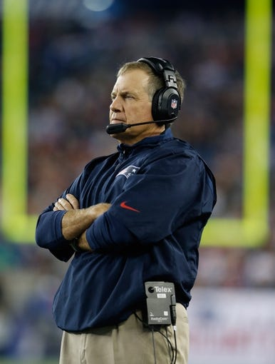 Aug 29, 2013; Foxborough, MA, USA; New England Patriots head coach Bill Belichick watches from the sideline as they take on the New York Giants in the third quarter at Gillette Stadium. Mandatory Credit: David Butler II-USA TODAY Sports