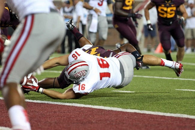 Aug 29, 2013; Minneapolis, MN, USA; UNLV Rebels tight end Taylor Barnhill (16) dives across the goal line for a touchdown in the fourth quarter against the Minnesota Golden Gophers at TCF Bank Stadium. The Gophers won 51-23. Mandatory Credit: Jesse Johnson-USA TODAY Sports