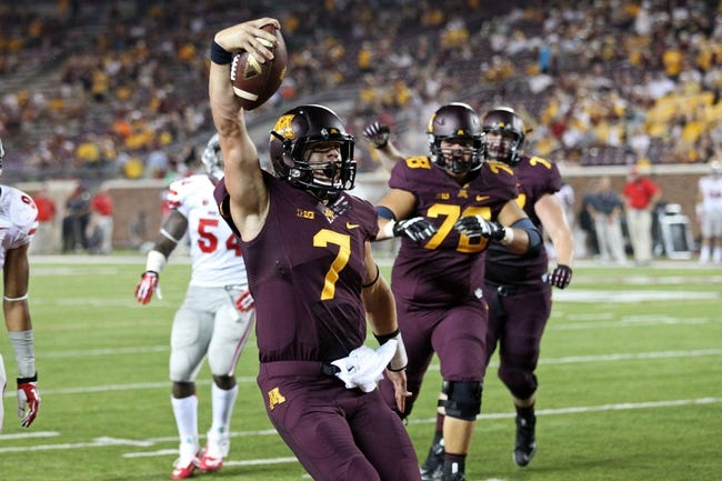 Aug 29, 2013; Minneapolis, MN, USA; Minnesota Golden Gophers quarterback Mitch Leidner (7) celebrates after scoring a touchdown in the fourth quarter against the UNLV Rebels at TCF Bank Stadium. The Gophers won 51-23. Mandatory Credit: Jesse Johnson-USA TODAY Sports