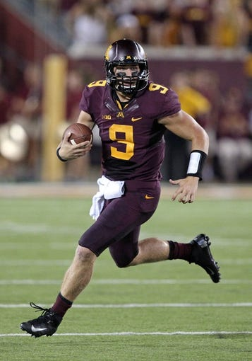 Aug 29, 2013; Minneapolis, MN, USA; Minnesota Golden Gophers quarterback Philip Nelson (9) runs with the ball in the third quarter against the UNLV Rebels at TCF Bank Stadium. The Gophers won 51-23. Mandatory Credit: Jesse Johnson-USA TODAY Sports