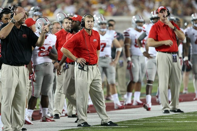 Aug 29, 2013; Minneapolis, MN, USA; UNLV Rebels head coach Bobby Hauck looks on from the sidelines in the third quarter against the Minnesota Golden Gophers at TCF Bank Stadium. The Gophers won 51-23. Mandatory Credit: Jesse Johnson-USA TODAY Sports