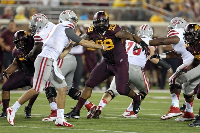 Aug 29, 2013; Minneapolis, MN, USA; Minnesota Golden Gophers defensive lineman Ra'Shede Hageman (99) gets into the backfield in the third quarter against UNLV Rebels at TCF Bank Stadium. The Gophers won 51-23. Mandatory Credit: Jesse Johnson-USA TODAY Sports