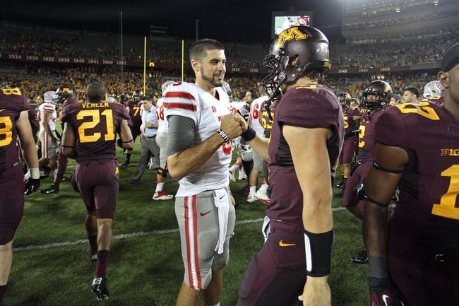 Aug 29, 2013; Minneapolis, MN, USA; UNLV Rebels quarterback Nick Sherry (3) and Minnesota Golden Gophers quarterback Philip Nelson (9) shake hands at the end of the game at TCF Bank Stadium. The Gophers won 51-23. Mandatory Credit: Jesse Johnson-USA TODAY Sports