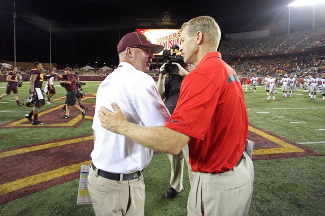 Aug 29, 2013; Minneapolis, MN, USA; Minnesota Golden Gophers head coach Jerry Kill and UNLV Rebels head coach Bobby Hauck shake hands at the end of the game at TCF Bank Stadium. The Gophers won 51-23. Mandatory Credit: Jesse Johnson-USA TODAY Sports