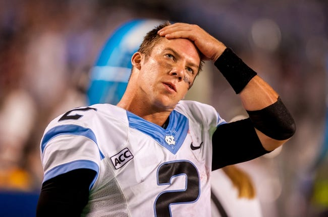 Aug 29, 2013; Columbia, SC, USA; North Carolina Tar Heels quarterback Bryn Renner (2) watches the clock tick away against the South Carolina Gamecocks in the fourth quarter at Williams-Brice Stadium. Mandatory Credit: Jeff Blake-USA TODAY Sports