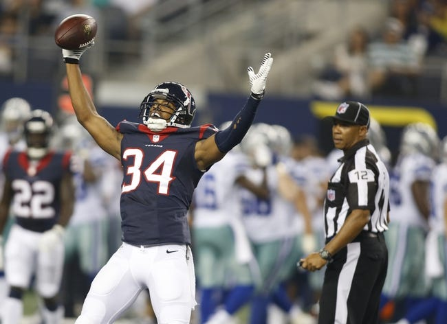 Aug 29, 2013; Arlington, TX, USA; Houston Texans cornerback A.J. Bouye (34) celebrates at the 50 yard line after an interception in the game against the Dallas Cowboys at AT&T Stadium. Houston beat Dallas 24-6. Mandatory Credit: Tim Heitman-USA TODAY Sports