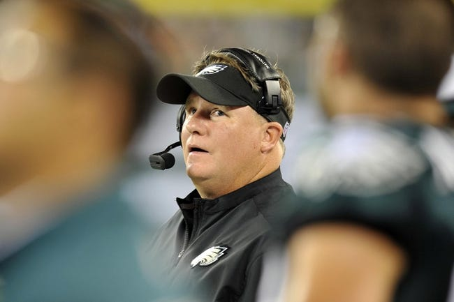 Aug 29, 2013; East Rutherford, NJ, USA; Philadelphia Eagles head coach Chip Kelly looks on against the New York Jets during the first half of a preseason game at Metlife Stadium. The Jets won 27-20. Mandatory Credit: Joe Camporeale-USA TODAY Sports