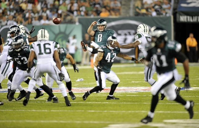 Aug 29, 2013; East Rutherford, NJ, USA; Philadelphia Eagles punter Donnie Jones (8) punts against the New York Jets during the first half of a preseason game at Metlife Stadium. The Jets won 27-20. Mandatory Credit: Joe Camporeale-USA TODAY Sports