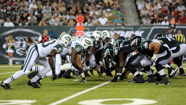 Aug 29, 2013; East Rutherford, NJ, USA; New York Jets and Philadelphia Eagles players line up for a field goal during the first half of a preseason game at Metlife Stadium. The Jets won 27-20. Mandatory Credit: Joe Camporeale-USA TODAY Sports