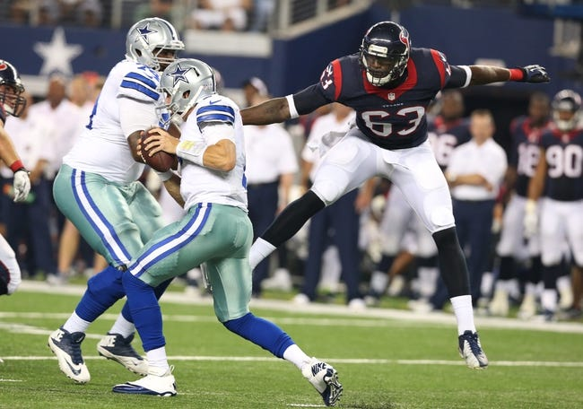 Aug 29, 2013; Arlington, TX, USA; Dallas Cowboys quarterback Alex Tanney (7) is pressured by Houston Texans linebacker Willie Jefferson (63) in the second half at AT&T Stadium. Mandatory Credit: Matthew Emmons-USA TODAY Sports