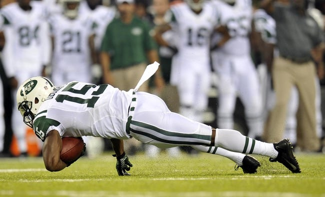 Aug 29, 2013; East Rutherford, NJ, USA; New York Jets wide receiver Ben Obomanu (15) dives after making a catch against the Philadelphia Eagles during the first half of a preseason game at Metlife Stadium. The Jets won 27-20. Mandatory Credit: Joe Camporeale-USA TODAY Sports