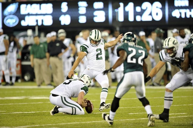Aug 29, 2013; East Rutherford, NJ, USA; New York Jets kicker Nick Folk (2) kicks a field goal against the Philadelphia Eagles during the second half of a preseason game at Metlife Stadium. The Jets won 27-20. Mandatory Credit: Joe Camporeale-USA TODAY Sports