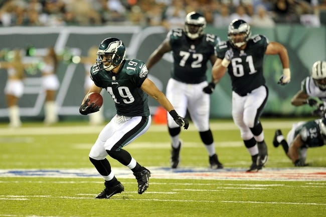 Aug 29, 2013; East Rutherford, NJ, USA; Philadelphia Eagles wide receiver Greg Salas (19) runs after a catch against the New York Jets during the second half of a preseason game at Metlife Stadium. The Jets won 27-20. Mandatory Credit: Joe Camporeale-USA TODAY Sports