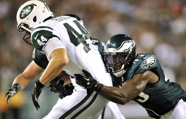 Aug 29, 2013; East Rutherford, NJ, USA; Philadelphia Eagles strong safety David Sims (43) tackles New York Jets tight end Chris Pantale (44) during the second half of a preseason game at Metlife Stadium. The Jets won 27-20. Mandatory Credit: Joe Camporeale-USA TODAY Sports