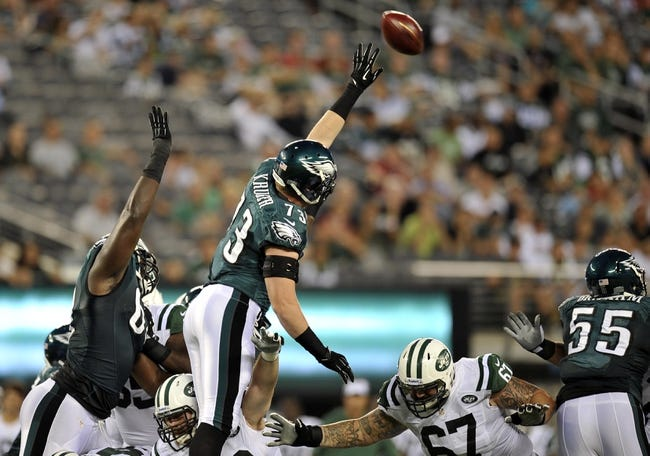 Aug 29, 2013; East Rutherford, NJ, USA; Philadelphia Eagles defensive end Joe Kruger (73) attempts to block a New York Jets kick during the first half of a preseason game at Metlife Stadium. The Jets won 27-20. Mandatory Credit: Joe Camporeale-USA TODAY Sports