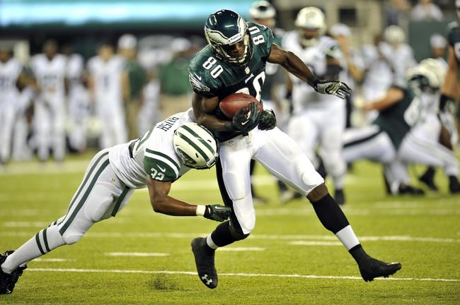 Aug 29, 2013; East Rutherford, NJ, USA; Philadelphia Eagles wide receiver Ifeanyi Momah (80) is tackled by New York Jets safety Josh Bush (32) during the second half of a preseason game at Metlife Stadium. The Jets won 27-20. Mandatory Credit: Joe Camporeale-USA TODAY Sports