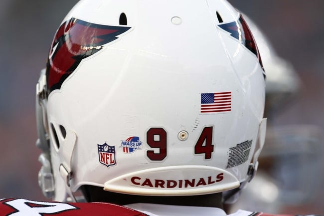 Aug 29, 2013; Denver, CO, USA; A detailed view of the helmet of Arizona Cardinals outside linebacker Sam Acho (94) showing the heads up football logo before the start of the game against the Denver Broncos at Sports Authority Field at Mile High. The Cardinals won 32-24. Mandatory Credit: Isaiah J. Downing-USA TODAY Sports