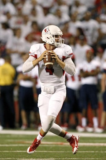 Aug 29, 2013; Fresno, CA, USA; Fresno State Bulldogs quarterback Derek Carr (4) looks to throw a pass against the Rutgers Scarlet Knights in the second quarter at Bulldog Stadium. Mandatory Credit: Cary Edmondson-USA TODAY Sports