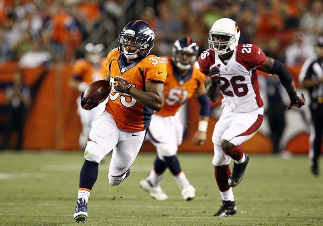 Aug 29, 2013; Denver, CO, USA; Denver Broncos running back Lance Ball (35) runs the ball in the third quarter against the Arizona Cardinals at Sports Authority Field at Mile High. The Cardinals won 32-24. Mandatory Credit: Isaiah J. Downing-USA TODAY Sports