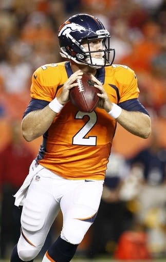 Aug 29, 2013; Denver, CO, USA; Denver Broncos quarterback Zac Dysert (2) in the fourth quarter against the Arizona Cardinals at Sports Authority Field at Mile High. The Cardinals won 32-24. Mandatory Credit: Isaiah J. Downing-USA TODAY Sports