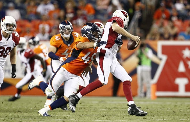 Aug 29, 2013; Denver, CO, USA; Denver Broncos linebacker Damien Holmes (49) tackles Arizona Cardinals quarterback Ryan Lindley (14) in the fourth quarter at Sports Authority Field at Mile High. The Cardinals won 32-24. Mandatory Credit: Isaiah J. Downing-USA TODAY Sports
