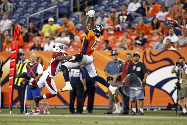 Aug 29, 2013; Denver, CO, USA; The ball goes through the hands of Denver Broncos wide receiver Gerell Robinson (10) in the fourth quarter against the Arizona Cardinals at Sports Authority Field at Mile High. The Cardinals won 32-24. Mandatory Credit: Isaiah J. Downing-USA TODAY Sports