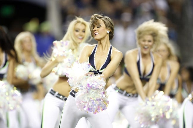 Aug 29, 2013; Seattle, WA, USA; Seattle Seahawks cheerleaders perform following the third quarter against the Oakland Raiders at CenturyLink Field. Mandatory Credit: Joe Nicholson-USA TODAY Sports