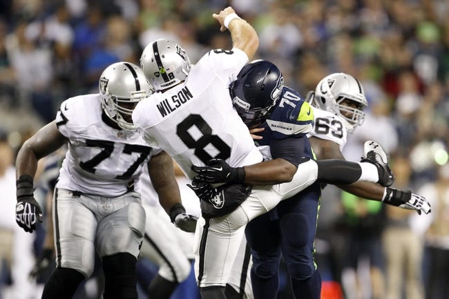 Aug 29, 2013; Seattle, WA, USA; Seattle Seahawks defensive tackle Michael Brooks (70) pressures Oakland Raiders quarterback Tyler Wilson (8) during the second half at CenturyLink Field. Mandatory Credit: Joe Nicholson-USA TODAY Sports