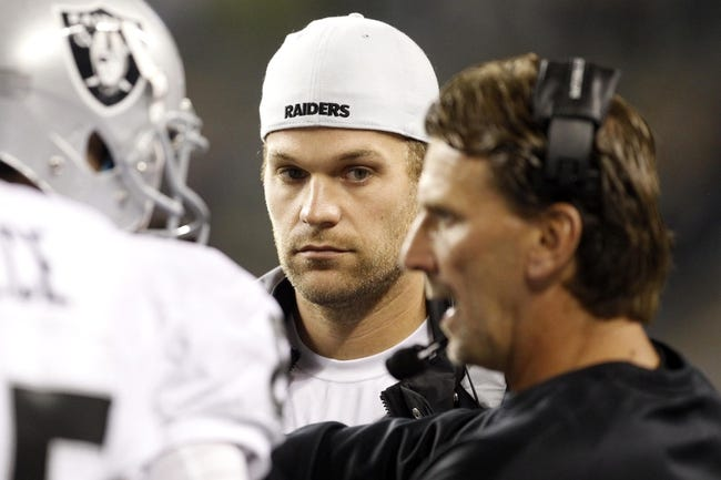 Aug 29, 2013; Seattle, WA, USA; Oakland Raiders quarterback Matt Flynn (15) listens to a coach during a fourth quarter timeout against the Seattle Seahawks at CenturyLink Field. Mandatory Credit: Joe Nicholson-USA TODAY Sports