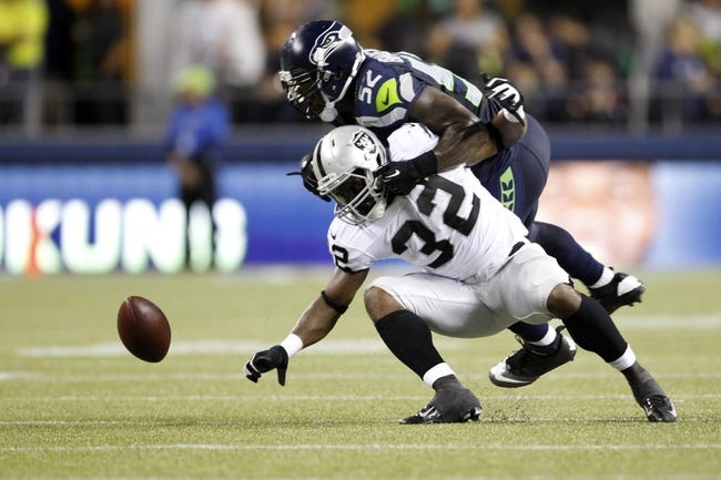 Aug 29, 2013; Seattle, WA, USA; Seattle Seahawks linebacker Allen Bradford (52) defends a pass intended for Oakland Raiders fullback Jeremy Stewart (32) during the second half at CenturyLink Field. Mandatory Credit: Joe Nicholson-USA TODAY Sports
