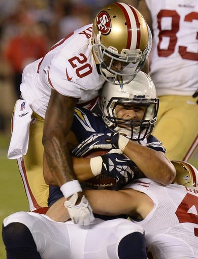 Aug 29, 2013; San Diego, CA, USA; San Diego Chargers running back Michael Hill (30) is tackled by San Francisco 49ers defensive back Perrish Cox (20) and strong safety Craig Dahl (43) during second half action at Qualcomm Stadium. Mandatory Credit: Robert Hanashiro-USA TODAY