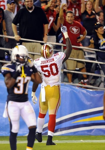 Aug 29, 2013; San Diego, CA, USA; San Francisco 49ers linebacker Cam Johnson (50) celebrates after recovering a blocked punt in the end zone for a touchdown during the second half against the San Diego Chargers at Qualcomm Stadium. Mandatory Credit: Christopher Hanewinckel-USA TODAY Sports