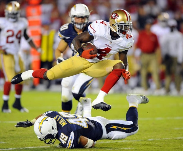 Aug 29, 2013; San Diego, CA, USA; San Francisco 49ers receiver Lavelle Hawkins (4) hurdles San Diego Chargers linebacker Dan Molls (49) on his way to a touchdown during the second half against the San Diego Chargers at Qualcomm Stadium. Mandatory Credit: Christopher Hanewinckel-USA TODAY Sports