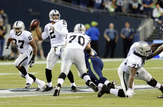 Aug 29, 2013; Seattle, WA, USA; Oakland Raiders quarterback Terrelle Pryor (2) passes the ball against the Seattle Seahawks during the game at CenturyLink Field. Seattle defeated Oakland 22-6. Mandatory Credit: Steven Bisig-USA TODAY Sports
