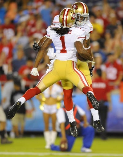 Aug 29, 2013; San Diego, CA, USA; San Francisco 49ers receiver Chuck Jacobs (1) celebrates with receiver Quinton Patton (11) after a touchdown during the second half against the San Diego Chargers at Qualcomm Stadium. Mandatory Credit: Christopher Hanewinckel-USA TODAY Sports
