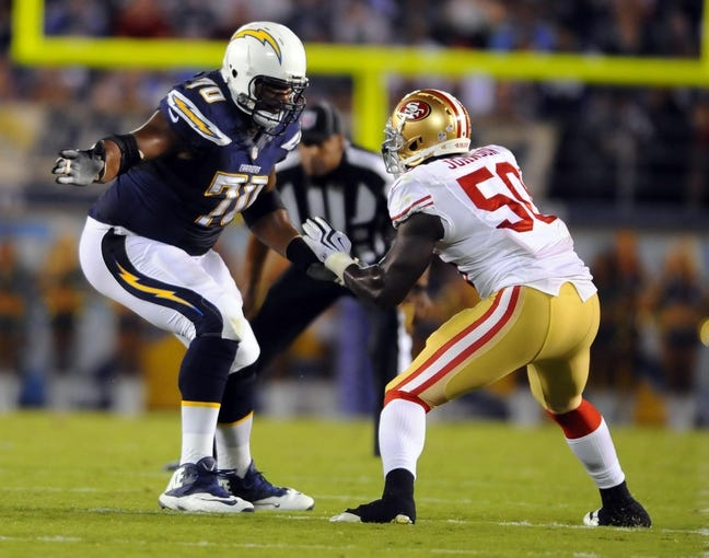 Aug 29, 2013; San Diego, CA, USA; San Diego Chargers offensive tackle Max Starks (70) blocks against San Francisco 49ers linebacker Cam Johnson (50) during the second half at Qualcomm Stadium. Mandatory Credit: Christopher Hanewinckel-USA TODAY Sports