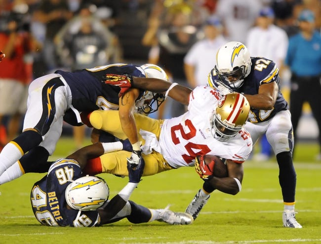 Aug 29, 2013; San Diego, CA, USA; San Francisco 49ers running back Anthony Dixon (24) is tackled after a short gain during the second half against the San Diego Chargers at Qualcomm Stadium. Mandatory Credit: Christopher Hanewinckel-USA TODAY Sports