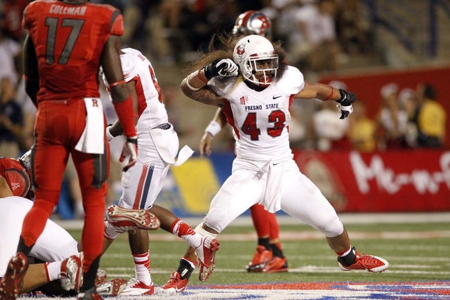 Aug 29, 2013; Fresno, CA, USA; Fresno State Bulldogs linebacker Karl Mickelsen (43) reacts after making a tackle against the Rutgers Scarlet Knights in the fourth quarter at Bulldog Stadium. The Bulldogs defeated the Scarlet Knights 52-51 in overtime. Mandatory Credit: Cary Edmondson-USA TODAY Sports