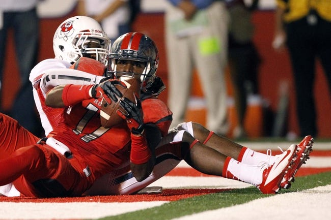 Aug 29, 2013; Fresno, CA, USA; Rutgers Scarlet Knights wide receiver Brandon Coleman (17) holds onto the ball after catching a touchdown against the Fresno State Bulldogs in overtime at Bulldog Stadium. The Bulldogs defeated the Scarlet Knights 52-51 in overtime. Mandatory Credit: Cary Edmondson-USA TODAY Sports
