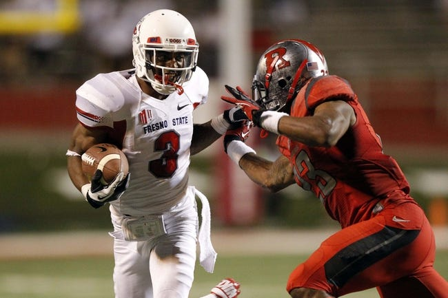 Aug 29, 2013; Fresno, CA, USA; Fresno State Bulldogs wide receiver Josh Harper (3) tries to elude Rutgers Scarlet Knights defensive back Ian Thomas (23) after making a catch in the fourth quarter at Bulldog Stadium. The Bulldogs defeated the Scarlet Knights 52-51 in overtime. Mandatory Credit: Cary Edmondson-USA TODAY Sports